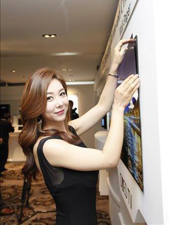 LG unveils 0.97mm press-on wallpaper OLED TV