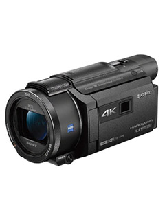 The Sony Handycam FDR-AXP55 4K camcorder has a 20x optical zoom lens and built-in projector