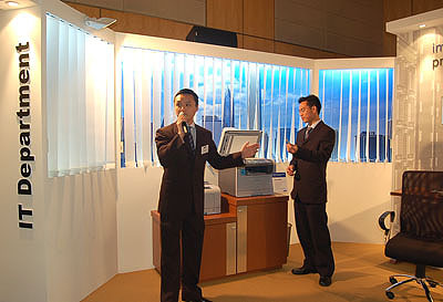A Samsung spokesperson demonstrating the seamless PictBridge technology found on some Samsung network printer models.