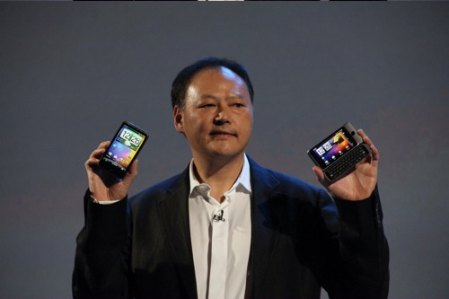 Peter Chou, Chief Executive Officer for HTC holds up the company's two new devices, the HTC Desire HD (left) and the HTC Desire Z (right).