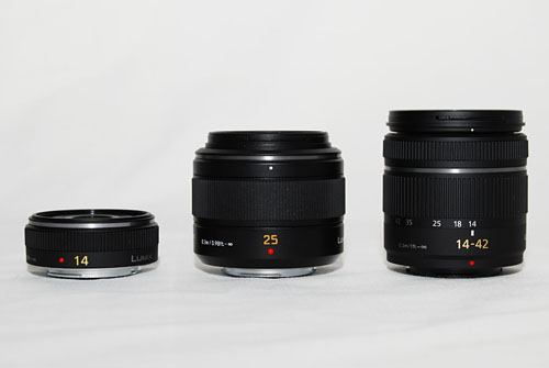 The 25mm (center) in comparison with Panasonic's 14mm (left) pancake lens and 14-42mm kit lens (right).