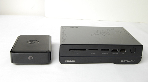For size comparisons, we've the German Leopard tank aka the ASUS O!Play HD2 on the right and the Seagate GoFlex TV on the left.