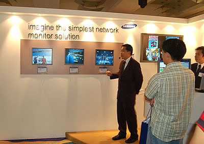 A Samsung spokesperson demonstrates the capabilities of their new monitors.