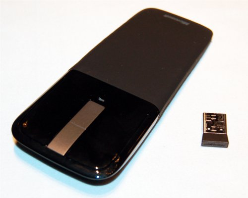 The Arc Touch mouse with its USB dongle for wireless connectivity.