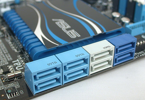 Underneath that low heatsink is the P67 chipset. Meanwhile, the SATA ports include four SATA 6Gbps (the gray and navy blue ones) and four SATA 3Gbps ports (in light blue), all aligned facing outwards for optimal cable management.