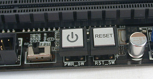 The power and reset buttons beside a hardware switch to enable ASUS' EPU processor which is in charge of optimizing the power consumption of the board.