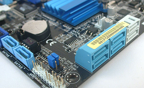 The two SATA ports in white here are SATA 6Gbps compatible. Two of the blue SATA 3Gbps ports are shunted to the left side and facing upwards, likely due to space constraints. You may also notice the two jumpers in between the SATA ports; these are related to overvoltage and will unlock the higher voltage values for memory and the QPI link in the BIOS.