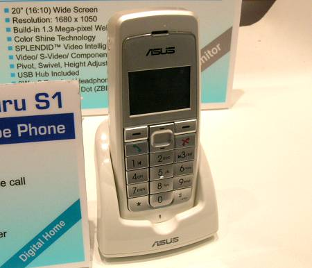 This simple looking mobile device is ASUS' new AiGuru S1, a weird cross between a wireless Skype phone as well as audio player remote. The phone features a proprietary communications protocol between the transmitter, supports Skype, Skype-In, Skype-Out and Skype Conference Call services, answering machine and can be used to control music playback on your PC.