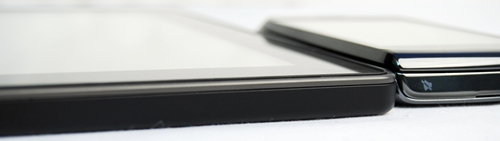 The PlayBook (left) is thinner than the BlackBerry Torch (right), making it a truly portable device for people on-the-go.
