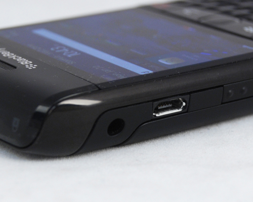 The microUSB port sits to the left, beside the voice dialer button and the 3.5mm audio jack.