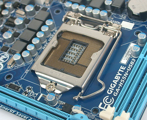 Again, space is limited and the CPU socket with the holes for the heatsink is uncomfortably close to the other components.