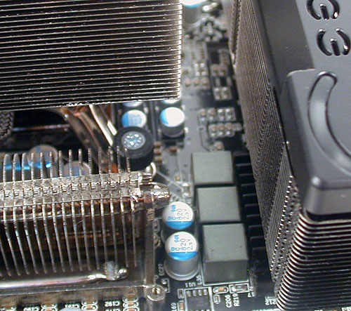 It was difficult to install Intel's stock cooler with the EVGA's chipset cooler so near to it. At least EVGA can claim that Intel released such a cooler after their own board has been out for quite a while.