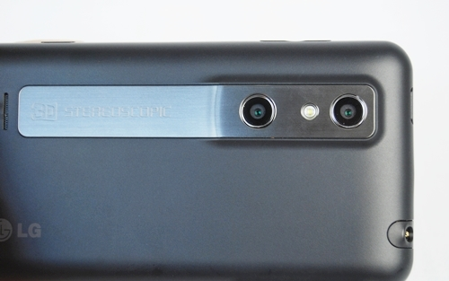 """The LG Optimus 3D comes with dual 5MP autofocus cameras and LED flash (while a secondary camera is located at the front for video conferencing purposes). The back looks polished with a strip of metal that exudes class. If you notice carefully, you can see the words """"3D Stereoscopic""""inscribed on the strip."""