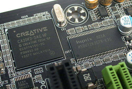 The Creative X-Fi chip, along with its own dedicated memory module. So you'll get the complete Creative suite of supported technologies, from EAX 5.0 to the X-Fi Crystalizer. As part of its gamer-oriented features, the board also has high capacity amplifiers able to drive 150Ω loads, which together with the proper high-quality headphones, will lead to less distortion and crisper audio.