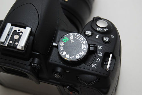 A Shooting Mode dial below the Mode dial helps you get to different shooting modes like single or timed with the push of a finger.
