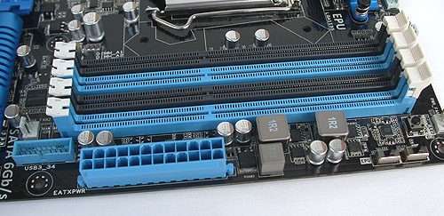 The expected four DIMM slots on this dual-channel memory architecture is more determined by the Sandy Bridge processor rather than the chipset or motherboard. Notice the single USB 3.0 header besides the 24-pin power connector.