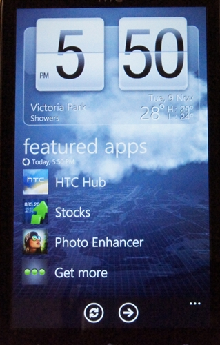A huge weather widget greets you on the HTC Hub startup page.