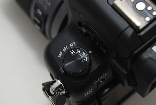 A auto-focus mode dial has been added on top of the focus mode lever. The GH2 gives you quick access to most manual settings.