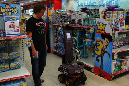 One RoboCup@Home challenge found robots shopping inside Toys 'R' Us. Robots had to follow their makers around the shop, identify specific items and pick them back up later. This marked the first time this challenge was held in a real-world location, instead of a simulated environment.