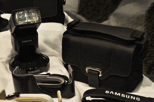 A Samsung SEF42A flash attachment (left) with flexible flash head and Samsung NX camera bag (right).