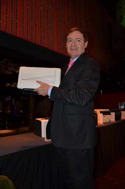 James Henderson, President, Asia Pacific & China of Fuji Xerox Printer Channel, holds the small DocuPrint P205 b.