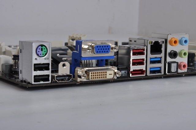 Here is a closer look at the board's rear side connectors, which feature an ample variety of video output options. Besides that, there are several USB 2.0/3.0 ports, analog and digital audio ports and the traditional PS/2 connector.