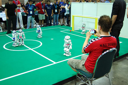 Competitors from the RoboCup Soccer league face off.