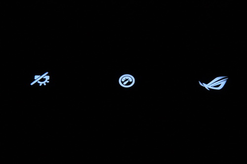 These backlit icons are actually the three hot keys located just above the keyboard. The first one from left is for activating the keyboard's backlighting. The middle is for adjusting power consumption. The last one, an ROG icon, is for enabling 3D vision.