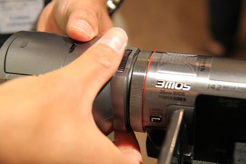 Detaching and re-attaching the 3D conversion lens on the SDT750 is simple enough.