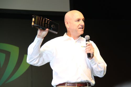 Drew Henry, General Manager for Desktop GPU business at NVIDIA holds up the GeForce GTX 480 card to the audience.
