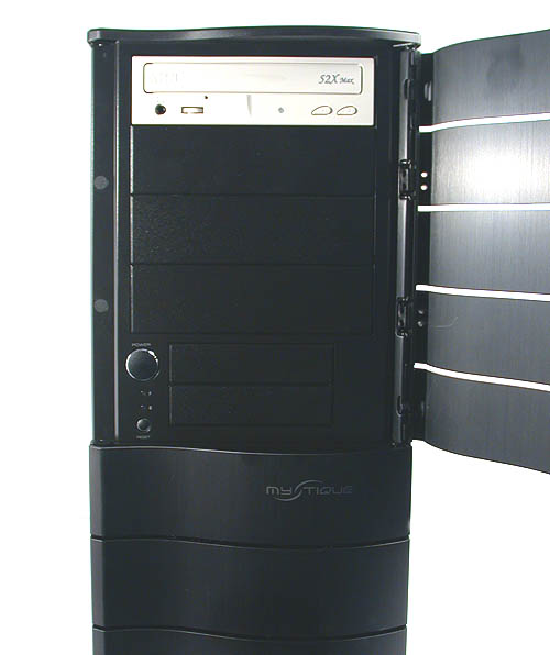 Behind that curved door lies a familiar sight. Up to four 5.25-inch external drive bays are allowed in this mid-tower, along with two external 3.5-inch drives. The standard power, reset and the usual LED indicators are all present.