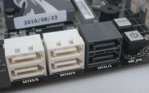 All six of these SATA ports, including the two SATA 6Gbps ones in black, are from the Intel P67 chipset and aligned the right way. Power and reset buttons are also found nearby.