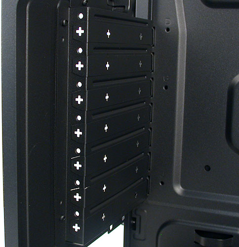 As you can see, all the expansion slots require a screwdriver and you have to bash the slots open with it first too.