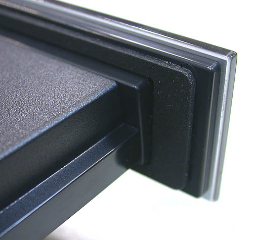 There is a layer of foam on the tray door that helps to keep noise levels down.