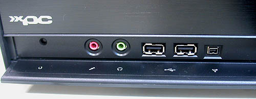 As usual, the front connectivity ports are hidden at the front bottom of the casing behind a panel. The standard ports like USB2.0, microphone and audio jacks are found, including a mini FireWire port. There's also a tiny Reset button.