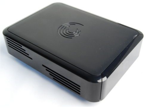 The Seagate FreeAgent GoFlex TV is a fingerprint magnet with its glossy look and feel. The front face is facing southeast in this picture, which means what you see here are the vents on the sides of the media player.