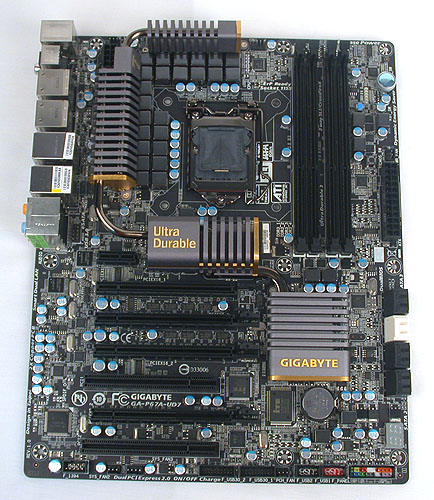 Black gold and heavy. That's our initial impression of Gigabyte's top P67 board currently, the UD7.