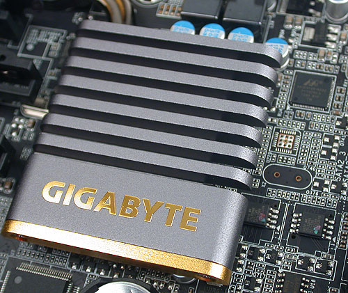 Gigabyte's logo looks extremely nice here in gold on the chipset heatink. On its right is the Marvell storage controller.