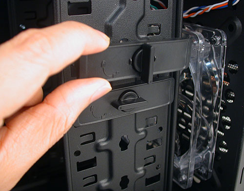 The 3.5-inch drive bays for your hard drives are also tool-free. This 'clip' holds the drive in place and all you need is to twist and pull out. Take note that there's a corresponding one on the other side, which means you will need to remove both side panels.