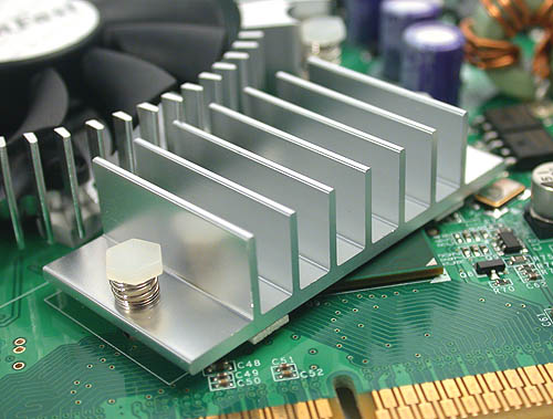 Beneath this heatsink is the bridge chip that makes it all possible, the High Speed Interconnect that allows the native PCIe GPU to 'talk' through the AGP interface.