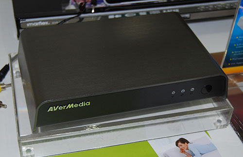 One of AVerMedia's newer products is the HomeFree Combo, which is a streaming device that enables up to two different users on two separate PC systems to watch TV programs without being in front of their TV. You'll have to connect this device to your set top box and a wireless router for it to work.