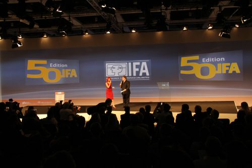 Miss IFA, the symbolic icon of the IFA consumer electronics show with her trademark red theme, greets journalists to the 50th edition of the show.