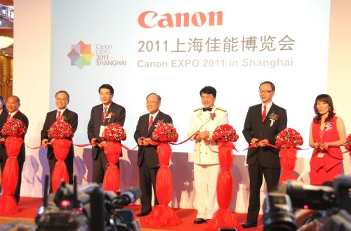 International star Jackie Chan (third from right) is the image ambassador for Canon at the EXPO in Shanghai. He jointly opened the EXPO 2011 event with Mr. Fujio Mitarai (fourth from right), Chairman of the Board and CEO of Canon Inc.; Mr. Tsuneji Uchida (second from left), President and COO of Canon Inc.; Mr. Hideki Ozawa (second from right), President of Canon Marketing Asia Group and President & CEO of Canon China;  and partners.