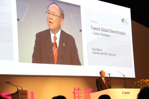 In his keynote speech to hundreds of dealers, partners and journalists, Mr Fujio Mitarai, CEO and Chairman of Canon Inc., said that the company must now move to expand its business functions and transform its manufacturing strategy to encompass localized production over the next five years (Phase IV under its Speed and Sound Growth strategy).