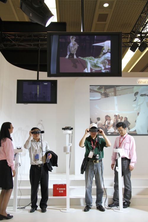 Canon also showed its Mixed Reality plans (or experiment). Basically users put virtual reality head-mounted glasses and is able to interact with their immediate environments in a sort of an augmented reality world. The idea works for industries dealing in graphic design prototyping, virtual storyboarding, theme park entertainment, education and many more. Pictured here are visitors watching virtual dinosaurs running around in front of them.