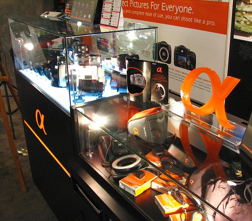 The showcase for the Sony Alpha A100, with its suite of lens and accessories.