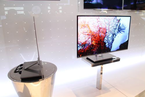 """LG Electronics has on display the world's slimmest Full HD 3D OLED TV with a 31"""" screen size. While the unit is a prototype, it has a thickness of only 0.29cm and has virtually no cross talk issues currently plaguing 3D-TVs using LED LCD or plasma technology, due to its use of fluorescent technology, not backlighting. The OLED TV impressed many journalists with its stunning color quality and design, and many expect it to cost an arm and a leg when plans are made to release it sometime next year."""