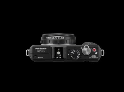 The top part of the LX5 has the newly incorporated turn-and-push jog dial and the 1:1 square format setting is added in the aspect ratio option which can be selected with the switch at the side of the lens barrel.