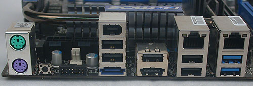 Besides the PS/2 ports, there's a small button to reset the BIOS and the special connector to link the board to MSI's OC Dashboard, which is an external display that shows relevant system information like temperature and voltages. You can even adjust and tweak settings via this Dashboard. Other ports here include dual Gigabit LAN, a pair of USB 3.0 ports, eSATA and FireWire.
