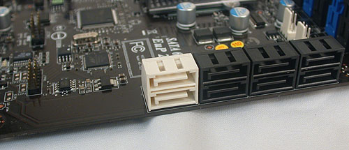 The two white ports are SATA 6Gbps versions, with six other black SATA 3.0Gbps ones. The amount of extra PCB besides the white SATA ports hint at this design being reused from a higher-end X58 board. Or it could just be the IDE connector that has been removed.